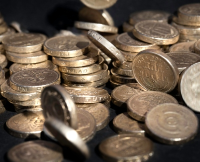 """British coins. Could be The economy, wages, home finance, savings, etc."""